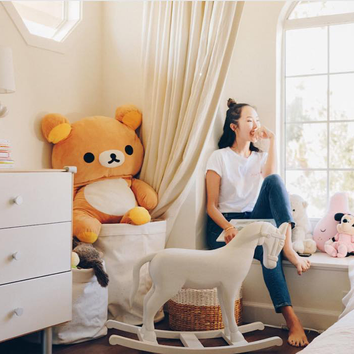 Instagram post of @chrisellelim in her room with a large Rilakkuma plush.