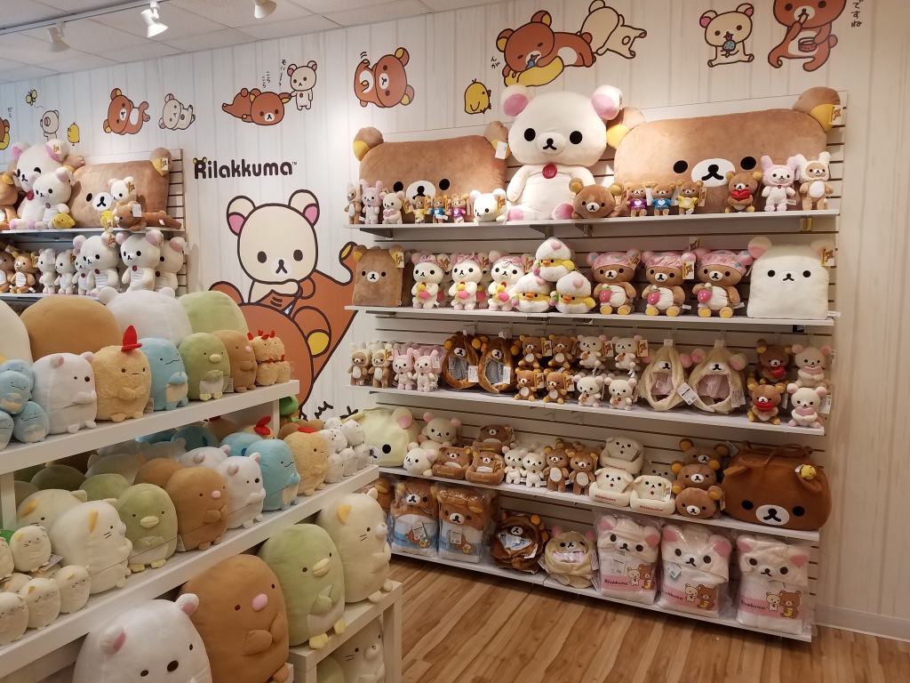 View of Rilakkuma plush shelf in Rilakkuma pop-up shop Florida.