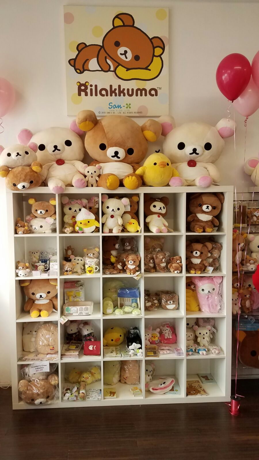 Shelf of Rilakkuma plush