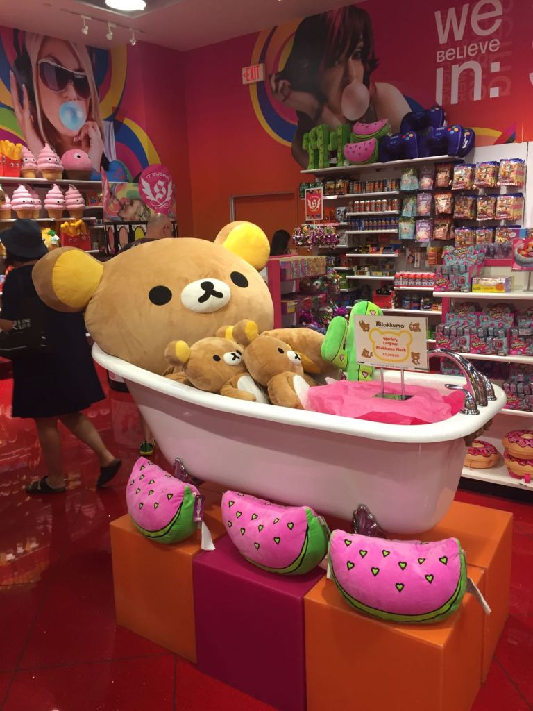 Mega Jumbo Rilakkuma and several large rilakkuma on display in a bathtub with watermelon plush.
