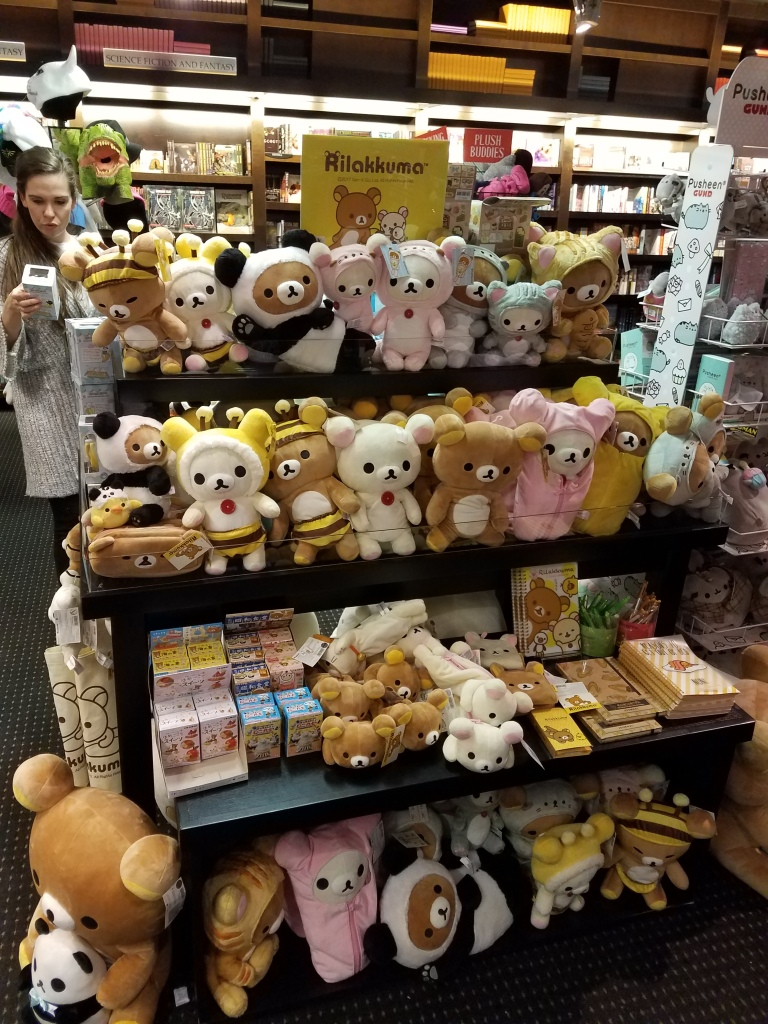 Rilakkuma plush displayed on a few tables.