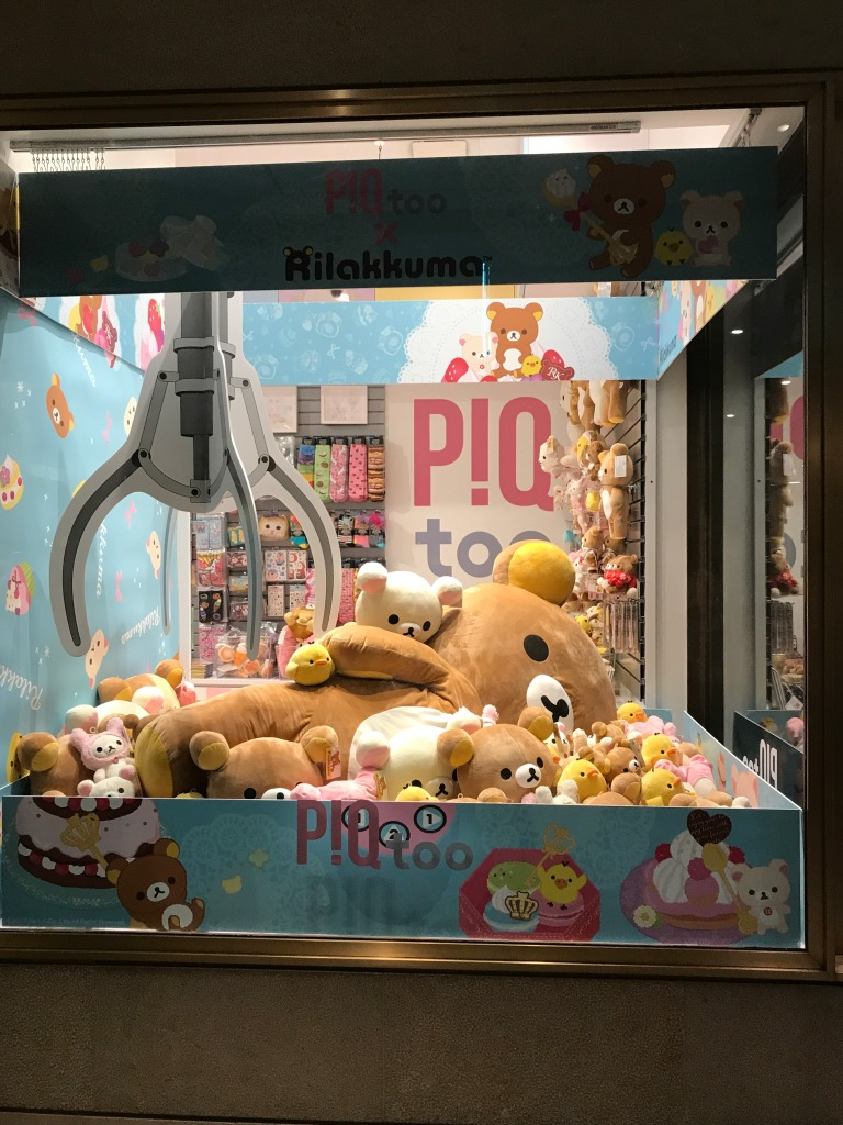 Mega Jumbo Rilakkuma in a glass display area meant to look like a crane machine. Many other Rilakkuma plush inside as well.