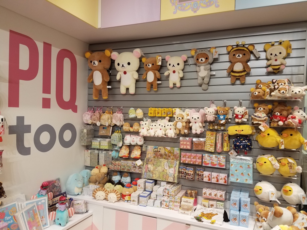 Display at PIQ shop showing a variety of Rilakkuma plush.