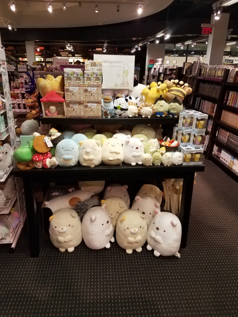 Sumikkogurashi plush displayed on a few tables