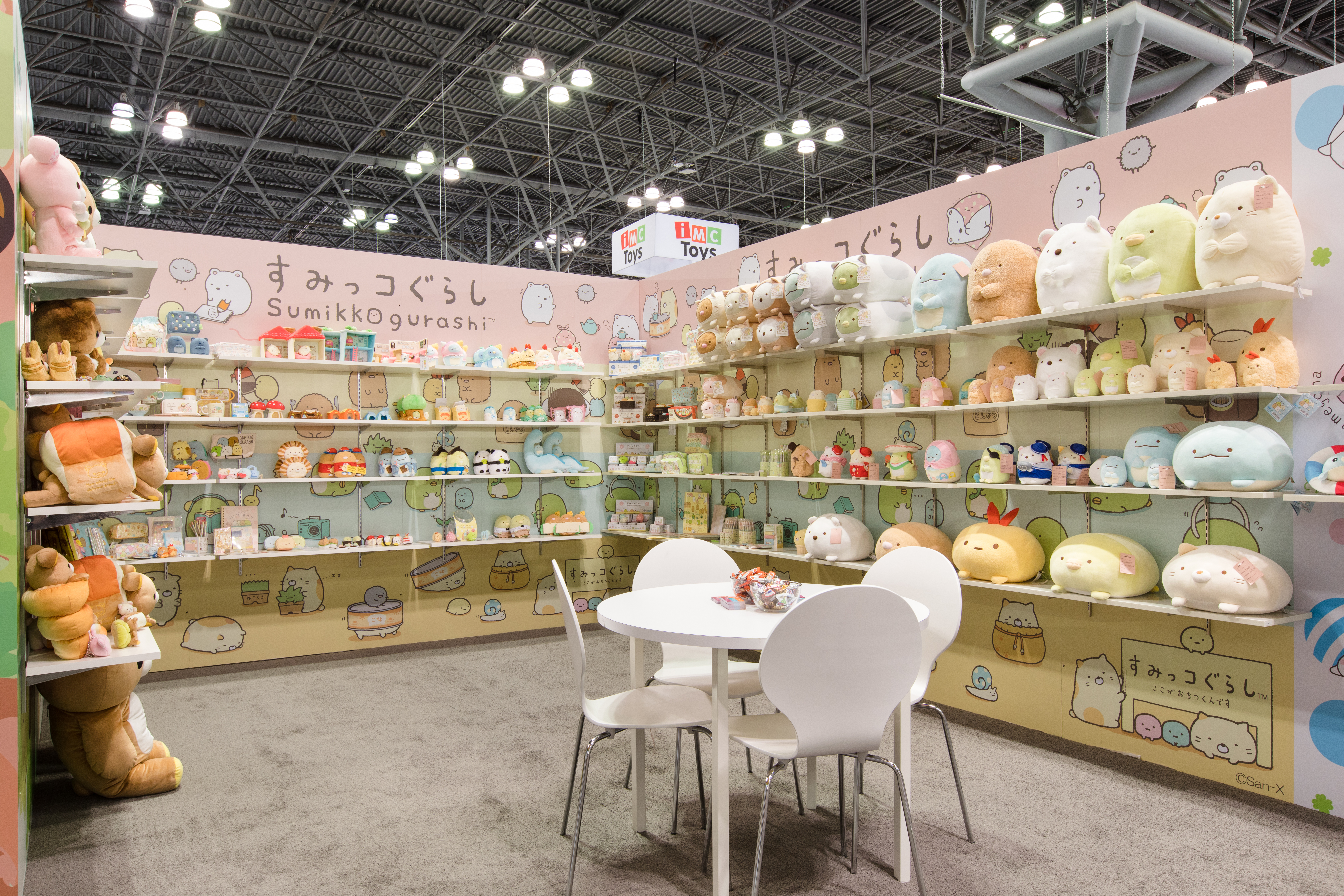 Sumikkogurashi section of New York Toy Fair 2019. 4 shelf rows on 2 walls filled with a varierty of Sumikkogurashi plush.